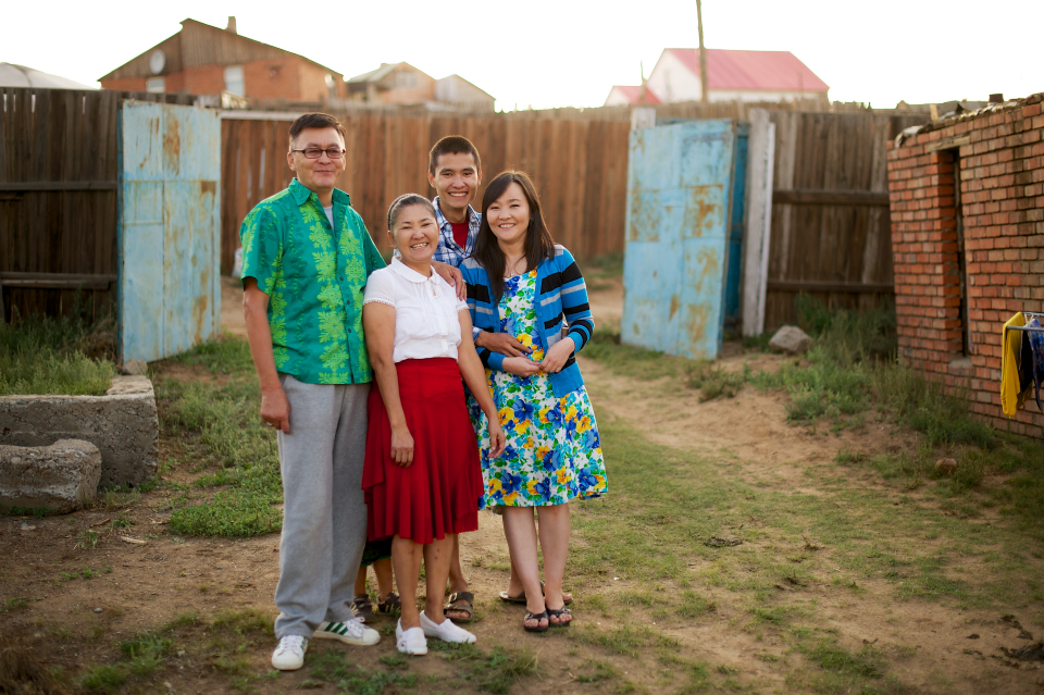 Family in Mongolia standing together outside and smiling