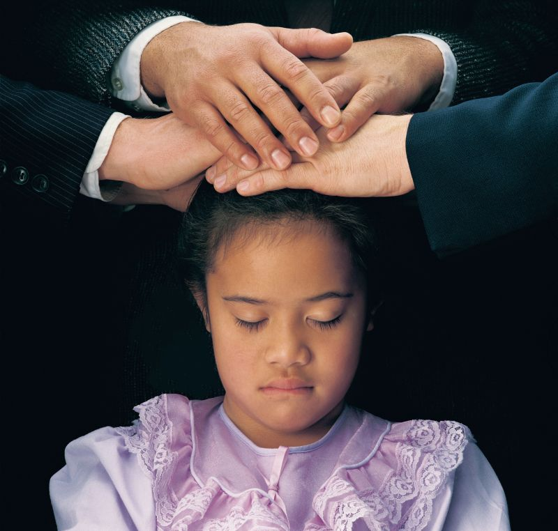 A girl receiving the Gift of the Holy Ghost
